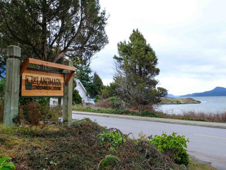 Landmark Sign with Water View
