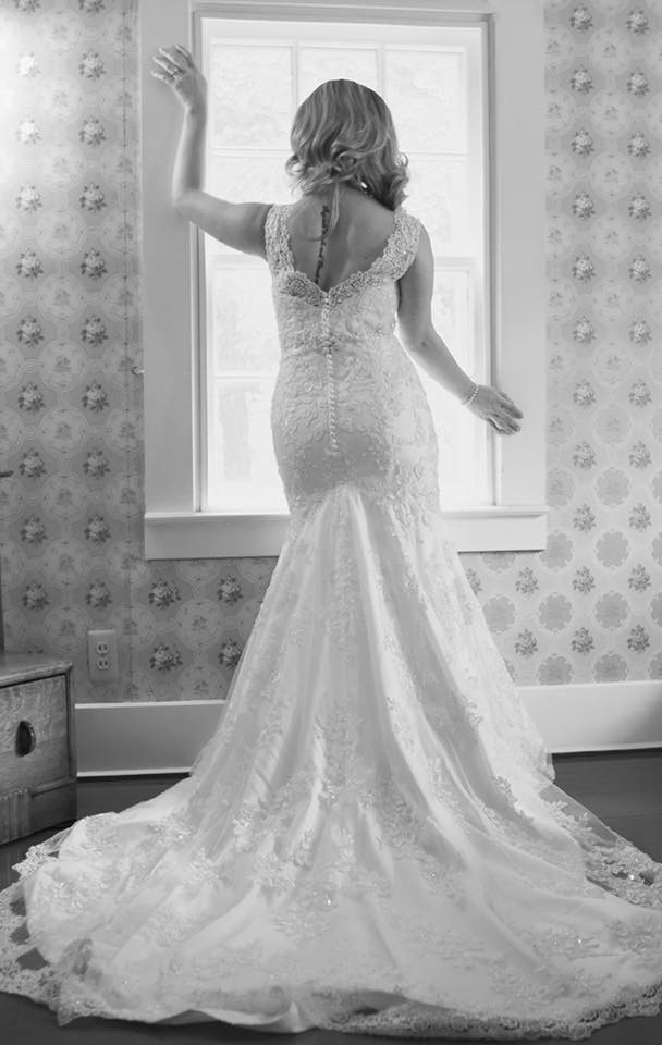 Black and white image of a bride in her gown before her wedding, shot by Katie and Doug Photography