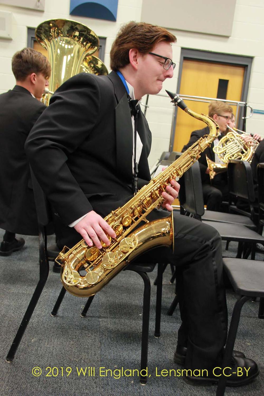 Saxophone Player warming up at rehearsal