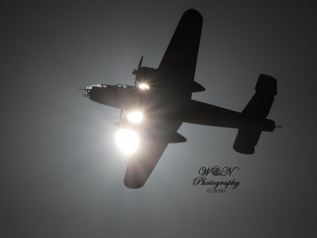 B25 Bomber Silhouetted Against the Sun