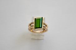 14kt Gold Parallelogram-cut green Tourmaline ring. Ladder band. Total stone weight: 3.94cts.                                    Price: $2150
