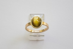 14kt Gold Catseye Opal ring. Cabochon-cut. Forged band.                                                 Price: $900