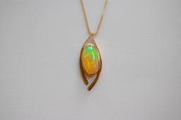 14kt Gold Ethiopian Opal Pendant and Chain.  Stone Weight: 4.01ct. Price: $1600