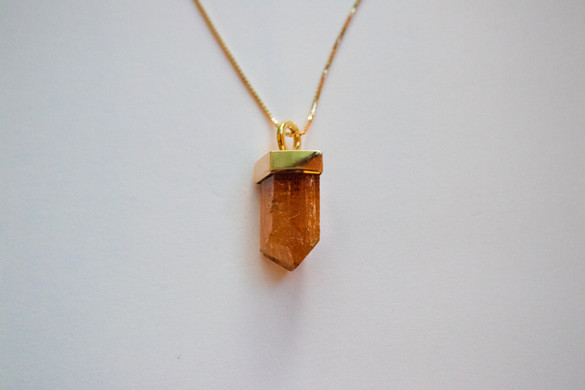 14kt Gold Imperial Topaz pendant and cord.                                    Price: $480 Price w/ Gold Chain: $650