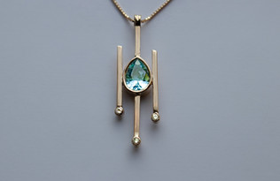 14kt Gold Pear Shaped Aquamarine Pendant with Diamonds Stone weight: 1.62 cts Price: $1600
