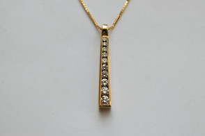 14kt Gold Graduated Diamond Pendant and Chain Stone weight: 55 pts VS/G Color Diamonds Price: $2400