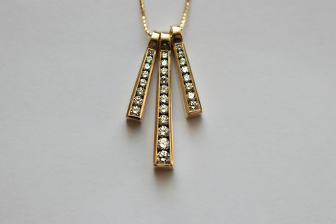 14kt Gold Triple Graduated Diamond Pendant and Chain Stone weight: 101 pts VS/G Color Diamonds Price: $4000  Note: This piece consists of two small and one large pendant which can be removed and worn seperately.   Please select 16 or 18 inch chain.