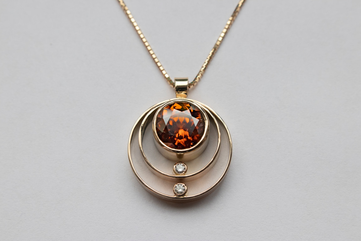14kt Gold Round Orange/Red Zircon and Diamond Pendant and Chain Stone weight: 3.80 cts + 6 pts DIA Diamonds (Tanzania) Price: $1800
