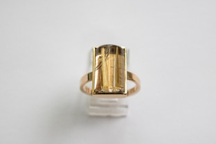 14kt Gold Rectangular-cut Rutilated Quartz ring. Round top.  Forged band.                                                                     Price: $890