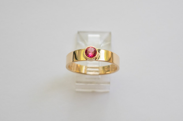 14kt Gold Round Ruby ring. Wide band. Total stone weight: 0.50cts.                                    Price: $900