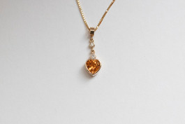 14kt Gold Heart Shaped Spessertite & Diamond Pendant Stone Weight: 1.69 Price: $2400