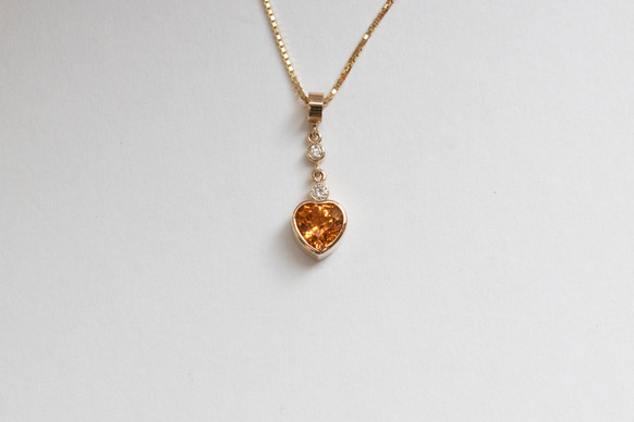 14kt Gold Heart Shaped Spessertite & Diamond Pendant Stone Weight: 1.69 Price: $2400