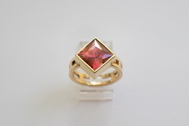14kt Gold Caddy corner square pink Tourmaline ring. Ladder band. Total stone weight: 5.43cts.                                     Price: $ 1600
