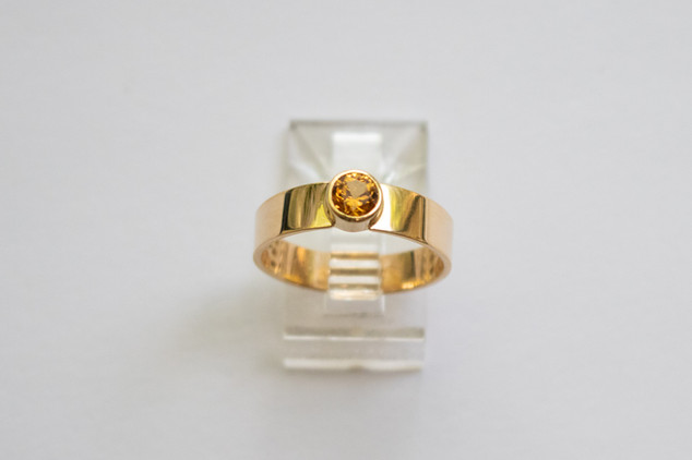 14kt Gold Yellow Grossular Garnet.  Wide band. Total stone weight: 0.59cts.                                    Price: $650