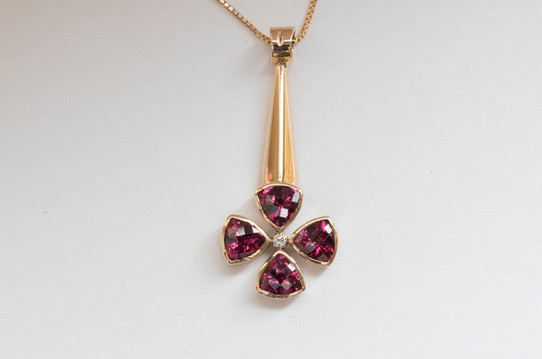 14kt Gold Quadrillion Rhodolite Garnet And Diamond Pendant Stone Weight: 4.48 cts Price: $1600
