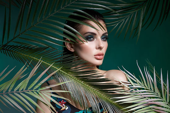tropical-portrait-sexy-woman-leaves-palm-tree-bright-green-makeup-shadow-palm-leaves-girl-