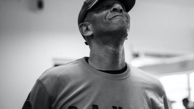 Black & white photo of Tony. Closeup shot. He has a big smile.
