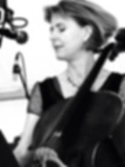 Helen Mountfort sitting with her cello