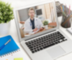 Doctor with a stethoscope on the compute