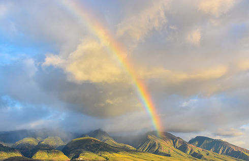 Rainbow over mountains. Authentic Gay Leadership coaching to turn your LGBT identity into leadership strength.