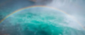 Image of rainbow over water on Authentic Gay Life coaching with a gay life coach.