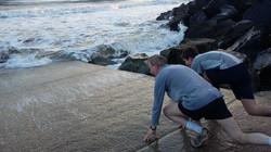 rob tim running into the sea