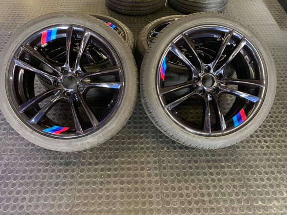 """20"""" BMW rims done in a custom color with custom BMW M colors"""