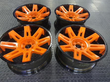 """20"""" MRW done in 2 tone ST orange center and glossy black dishes"""