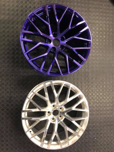 Audi R8 rims brought in for a one of a kind job - diamond cut face with a candy purple clear coat