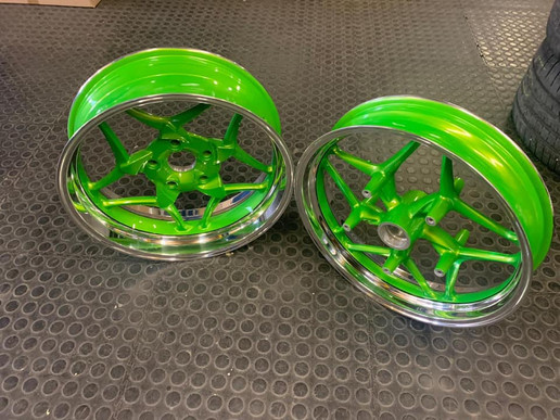 BMW bike rims done in a candy green with polished dish