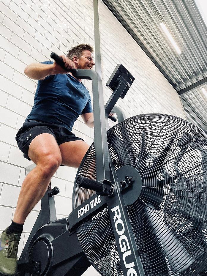 Athlete at The Bar Rotterdam Gym on Rogue Echo Bike Personal Training CrossFit
