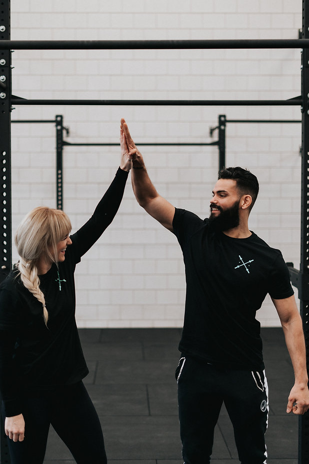 Pamela Thorburn and Christopher Soliana - owners of the Bar Rotterdam functional fitness personal training crossfit gym - high fiving