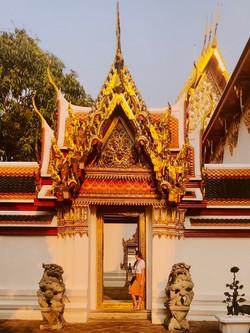 The Savvy International Founder visiting temples in Bangkok Thailand.