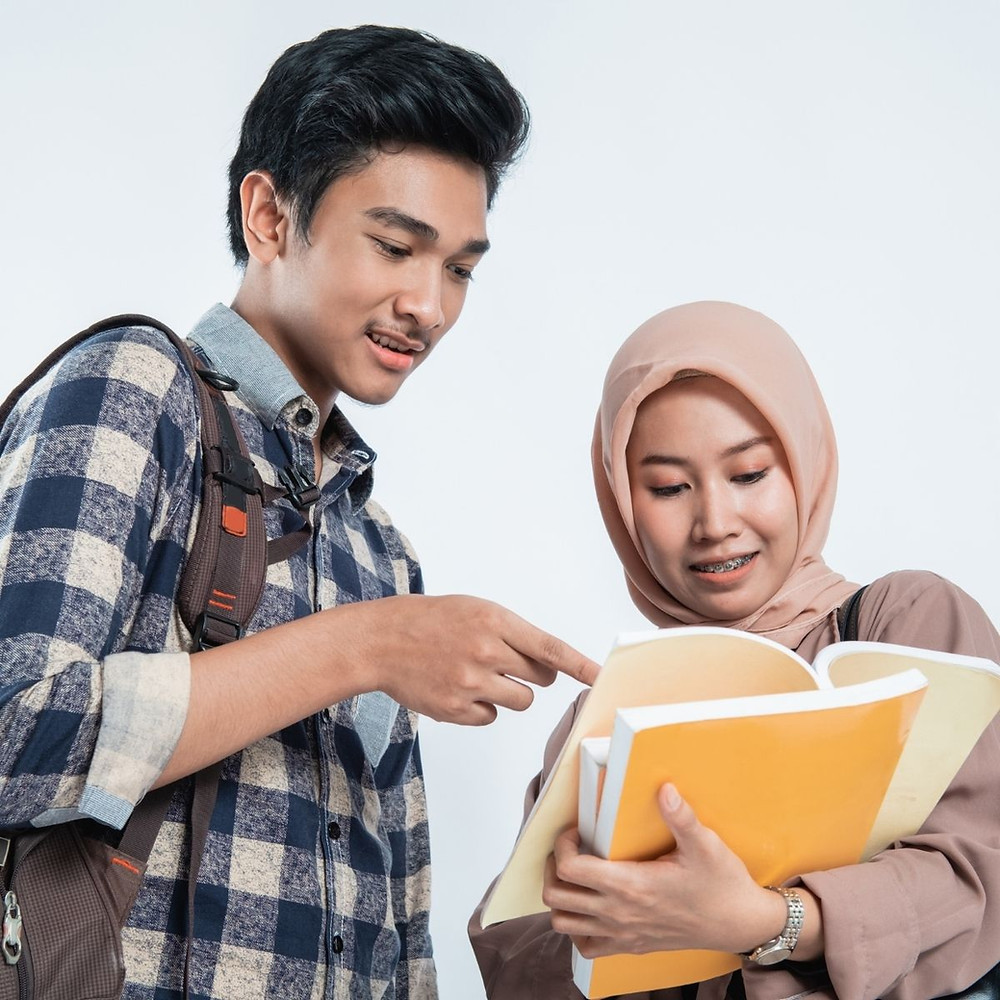 students reading books about university