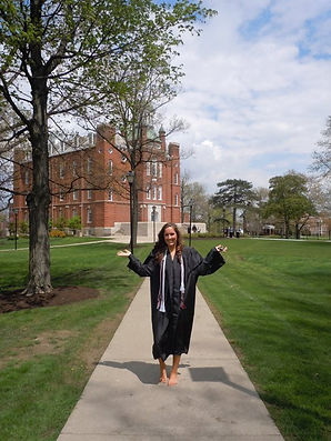 The Savvy International Founder, Cortney, posing on her university campus after graduation from undergraduate studies.