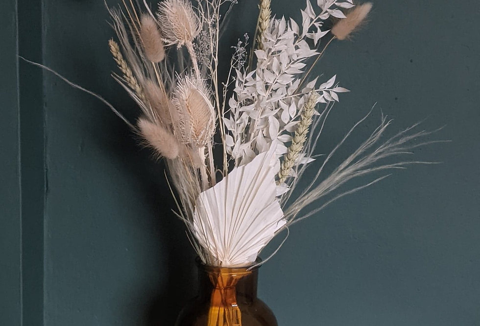 Small dried flower bunch in vase