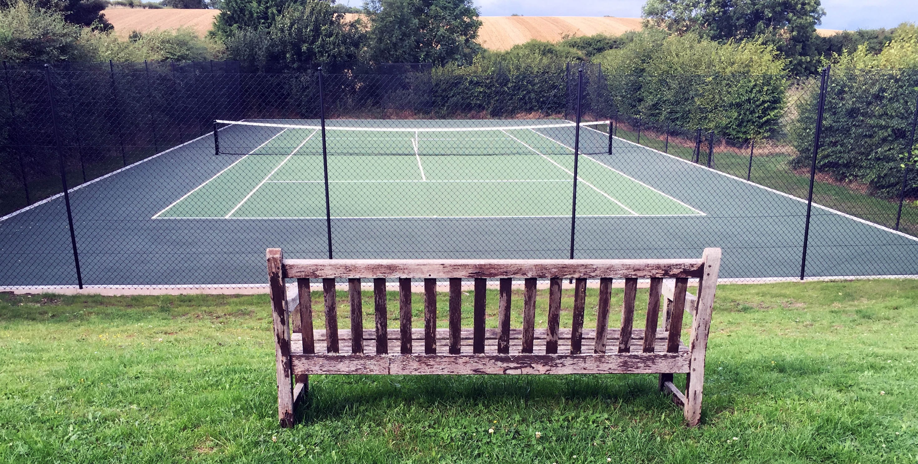 The all weather tennis court.