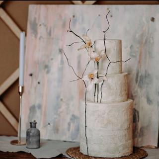 Three tier wedding cake with sugar flowe
