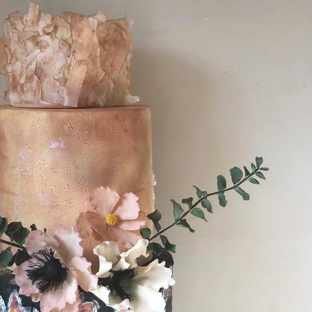 Three tier floral wedding cake