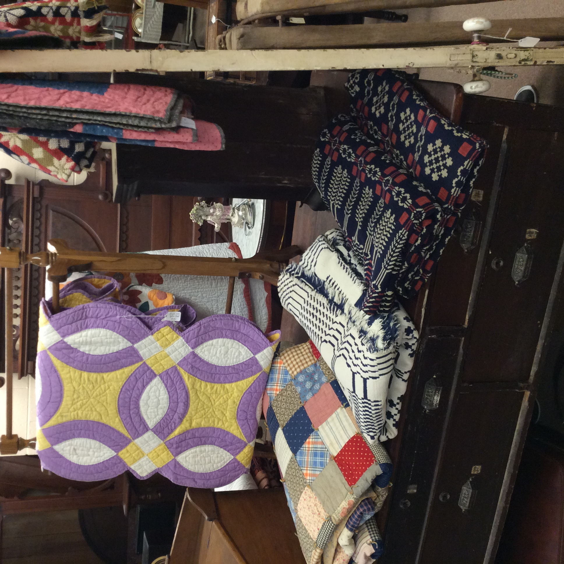Various quilts and coverlets