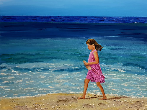 She is the girl in the pink on the ocean shore.