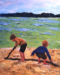 digging in the sand by the sea .  Buried treasure inspires kids into digging deep in the sand