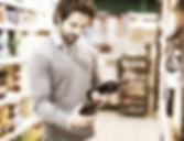 Man in a supermarket choosing a wine_edi