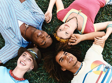 Group of people laying on the grass