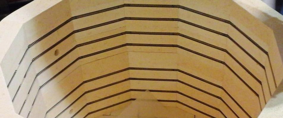 Coils inside bricks of the kiln