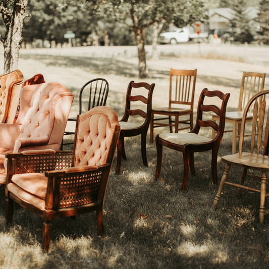 Clarence, Laura, Phoebe with assorted wood chairs