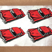 Four red Cadillacs