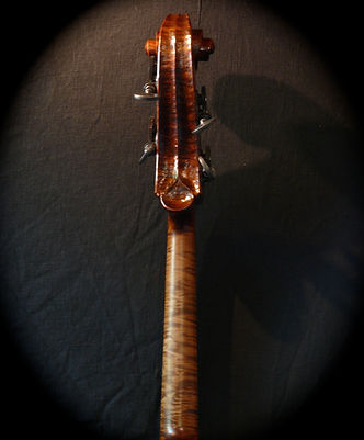 image of hand carved walnut bass neck and scroll©2017 by Seth Kimmel  Bass maker/luthier of American made, real wood, hand-carved, double bass violins; Eugene, Oregon, USA