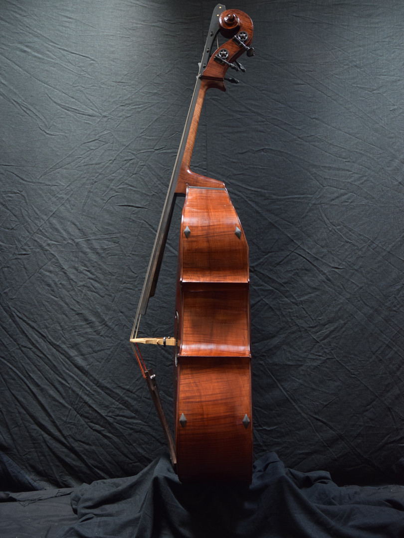 The instrument sounds fantastic. The high end is round and sweet and the low notes, tone, and volume are what one might expect from a much larger bass.  I am very pleased with this bass (as is it's new owner).
