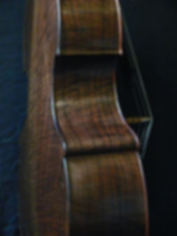 image of close up of Walnut Busetto corner ©2017 by Seth Kimmel  Bass maker/luthier of American made, real wood, hand-carved, double bass violins; Eugene, Oregon, USA